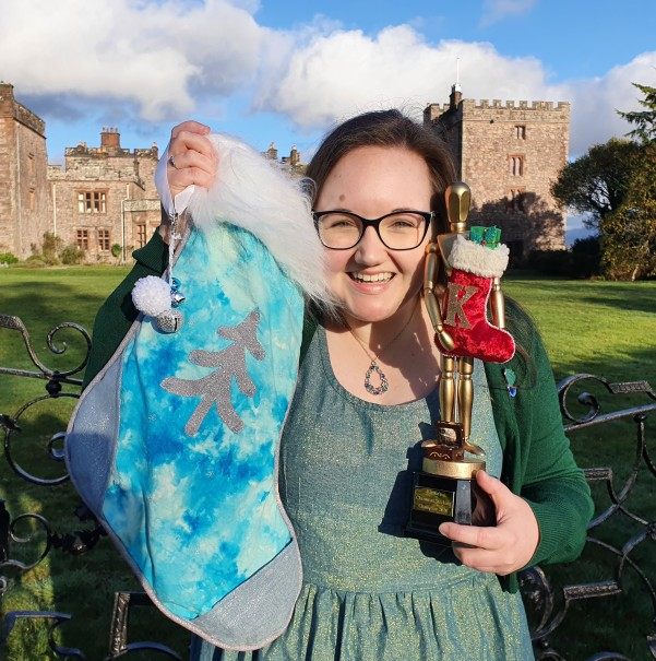kym-armstrong-with-winners-trophy-and-stocking-at-muncaster-castle.